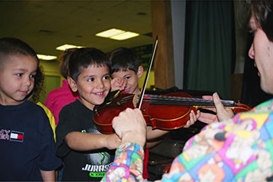 violinist houston tx works with child
